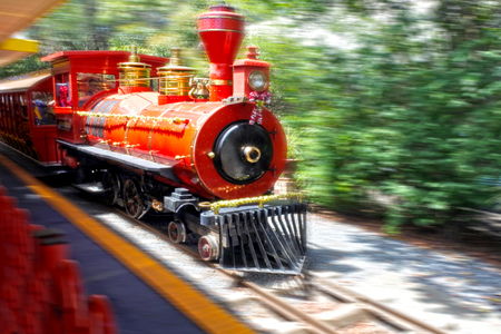 Motion blur of a red steam train on railway tracks