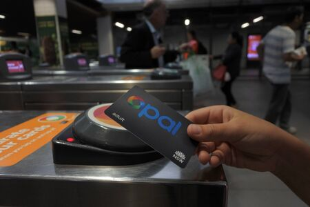 SYDNEY - FEB 21 2019:Opal Card User. Opal is a contact less smart card ticketing system for public transport services in the greater Sydney area of New South Wales, Australia.