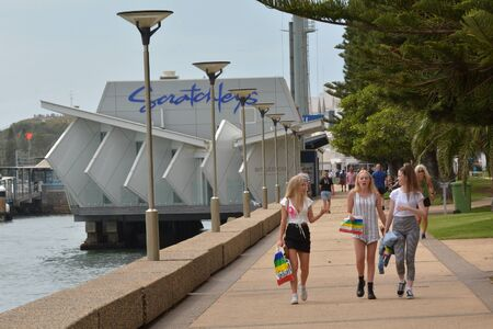 NEWCASTLE, NSW - FEB 2019: People walking along Foreshore Footpath in Newcastle New South Wales, Australia Stock Photo - 128988284