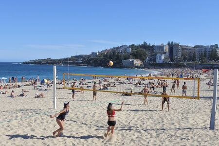 SYDNEY - FEB 21 2019:Young people plays volleyball on Coogee Beach a very popular beach and parkland in Sydney New South Wales, Australia.