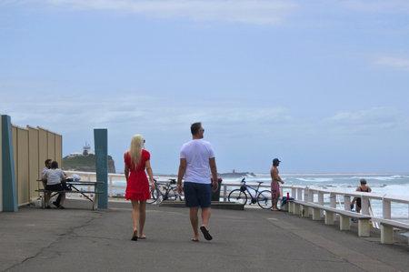NEWCASTLE, NSW - FEB 2019:Tourist walking along Shortland esplanade in Newcastle New South Wales, Australia