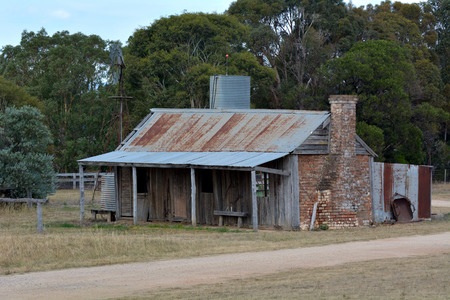 An old deserted Australian farm house in the outback of Canberra, Australia.