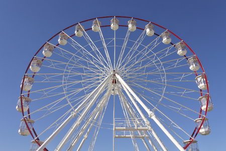 Giant Ferris Wheel against blue sky. Low angle view.