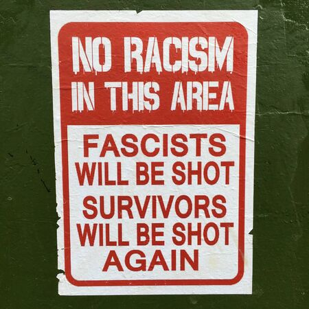 Sydney, Australia - February 20 2019: Sign reads: No Racism in this Area. Racism is the belief in the superiority of one race over another which results in discrimination and prejudice towards people race or ethnicity. Stock Photo - 128988481