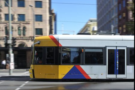 Adelaide, Australia - March 29 2019: Adelaide city tram in blurry motion. Adelaide Metro provides a free tram service in Adelaide the capital city of South Australia.