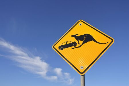 Beware of the kangaroo road sign against blue sky in central Australia outback