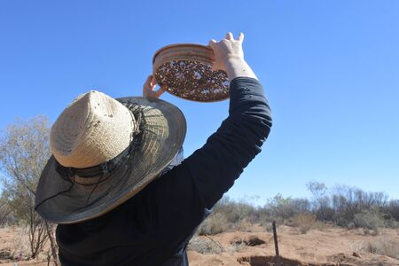 Australian woman fossicking (searching)  gem stones in the outback of the Northern Territory, Australia.