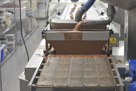 Adelaide, Australia - May 14 2019:Chocolate manufacture machinery in Chocolate factory.chocolate is the largest sub-category of the $34.5 billion confectionary industry, with sales accounting for $21.1 billion. 新聞圖片