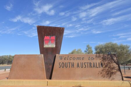 South Australia - May 22 2019: Welcome to South Australia sign on Stuart Highway The Explorer Way.South Australia shares borders with all of Australia mainland states.