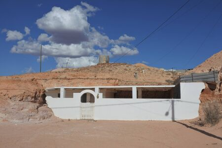 Coober Pedy, South Australia - May 20 2019: An underground home inside an old opal mine in Coober Pedy. Coober Pedy town supplying most of the worlds gem-quality opal.