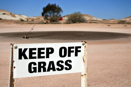 Coober Pedy, South Australia - May 15 2019:Coober Pedy Opal Fields Golf Course in South Australia,one of the most unique golf courses in the world were golf players can find Opals on the ground during a golf game.