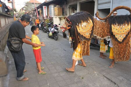 Ubud, Bali, Indonesia - July 25 2019:Barong Dance. Barong is a panther-like creature and character in the Balinese mythology of Bali, Indonesia.Barong dance represent the eternal battle between good and evil.