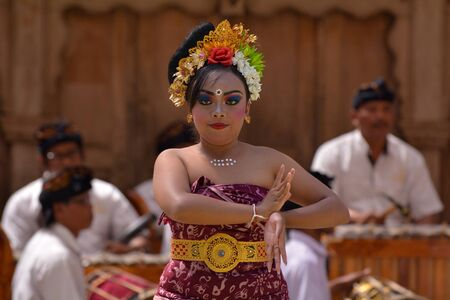Balinese woman dancing Tari Pendet Dance. Pendet is a traditional dance from Bali, Indonesia, in which floral offerings are made to purify the temple as a prelude to ceremonies.