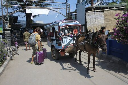 Gili Air, Bali, Indonesia - July 2019:Horse carriage in Gili Air Island. Gili Islands are so small that no motorized vehicles are allowed on the islands.