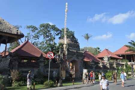 Ubud, Bali, Indonesia - July 27 2019: Visitors at Ubud Palace in Bali Indonesia.Puri Saren Agung is the palace of the Ubud royal family, making it one of the most prominent landmarks in Ubud.