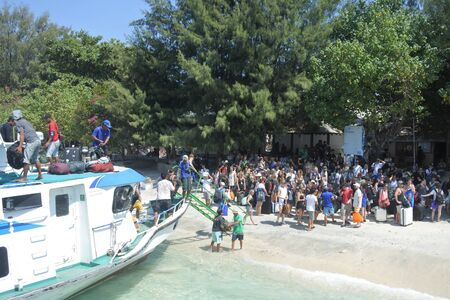 GIli Trawangan, Bali - August 04 2019:Tourists arriving departing to Gili Islands Bali Indonesia. Gili Island known for their pristine underwater world are a very popular travel destination for scuba divers 新聞圖片