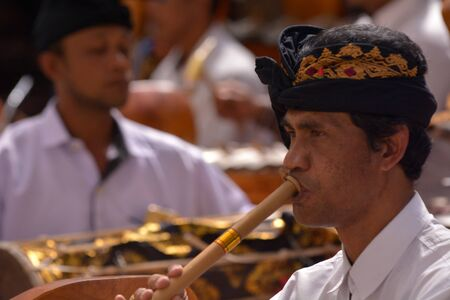 Bali, Indonesia - July 28 2019:Balinese gamelan orchestra playing traditional music. Gamelan is the traditional ensemble music of Java and Bali in Indonesia, made up predominantly of percussive instruments. 新聞圖片