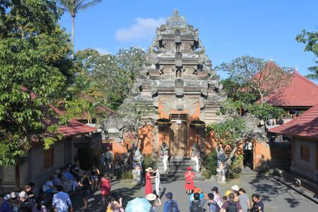 Ubud, Bali, Indonesia - July 27 2019: Visitors at Ubud Palace Bali Indonesia aerial view.Puri Saren Agung is the palace of the Ubud royal family, making it one of the most prominent landmarks in Ubud.