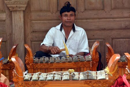 Balinese gamelan orchestra playing traditional music. Gamelan is the traditional ensemble music of Java and Bali in Indonesia, made up predominantly of percussive instruments.