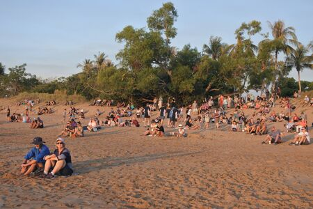 Darwin, Australia - June 23 2019:Australian people and tourist are watching the sunset from Mindil Beach a very popular tourist attraction in Darwin Northern Territory Australia