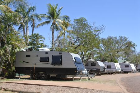 Caravans parking in outdoors campsite during summer travel holiday vacation.