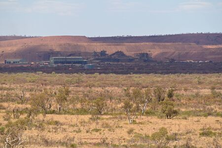 TOM PRICE, WA - OCT 2019:Mount Tom Price mine owned by Rio Tinto Iron Ore.  In 2016, Rio Tinto produced a total of 348 million tonnes of iron ore from its operations in Australia and Canada. Stock Photo