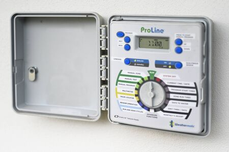 PERTH - JUNE 02 2020:Water irrigation controller, a device to operate automatic irrigation systems such as lawn sprinklers eliminate irrigated water lost to evaporation in the heat of the day.