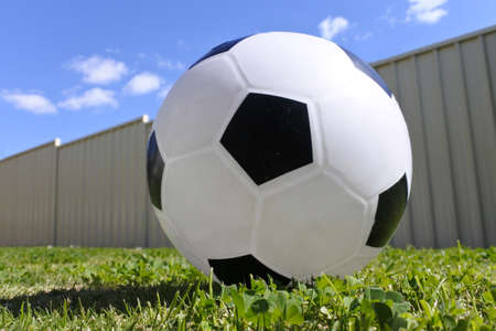 Low angle of a football on home lawn backyard