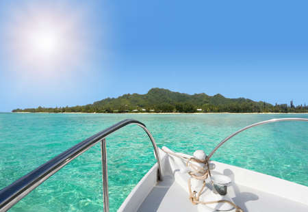 Landscape view of a tropical Island from a yacht sailboat point of view. No people. Copy space