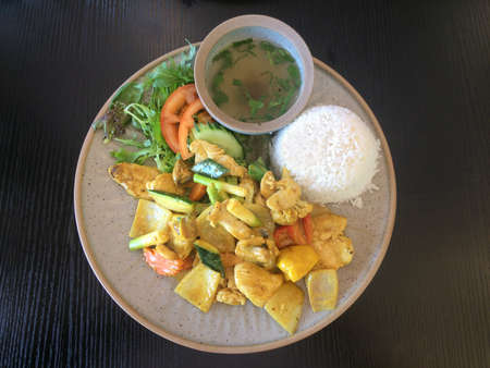 Vietnamese food chicken satay served with with rice, salad and soup. Reklamní fotografie