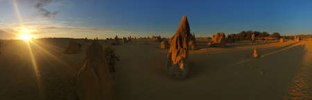 Panoramic landscape view of the Pinnacle desert limestone formations at sunset near Cervantes in Western Australia. Reklamní fotografie