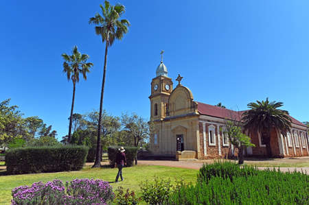 Adult Australian woman visiting at New Norcia cityscape. New Norcia is the only monastic town in Australia. Фото со стока