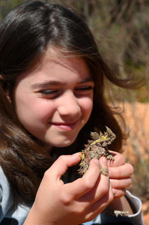 Young Australian girl (age 10) holding a Thorny Devil in Western Australia Outback