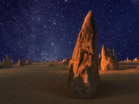 Stars over the landscape of the Pinnacle desert limestone formations at night near Cervantes in Western Australia.