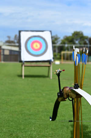 Modern bow, arrows and target background. Archery is the art, sport, practice, and skill of using a bow to shoot arrows.