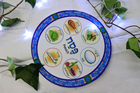 Above view of Seder plate on a table on Passover Jewish holiday night.