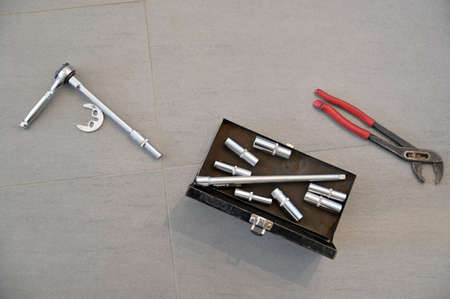 Flat lay of plumber working tools for fixing and repairing a water leaking at home. Stock fotó