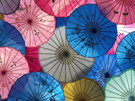 Colorful asian umbrellas abstract background and texture.