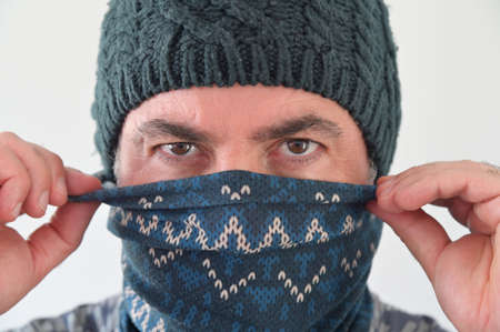 Middle Eastern Militant Man disguising his identity by wearing a beanie and balaclava face cover. Stock fotó