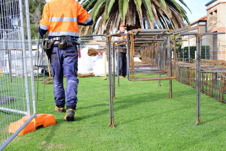 An unrecognizable Australian construction workers working outdoors.