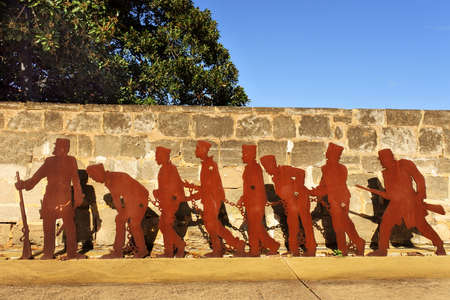 FREMANTEL, WA -JULY 18 2021:Silhouette of British prisoners entering Fremantle Prison. Fremantle Gaol initially used for convicts transported from Britain, but was transferred to the colonial government in 188 for local use.