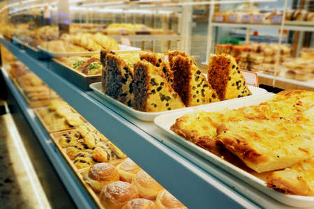 Selection of baking produces on display in bakery shop.