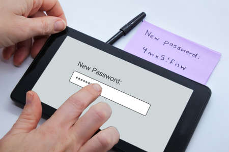 POV (point of view) of a  person changing new password on a tablet portable device. Cyber security concept.