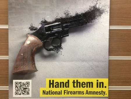 PERTH, WA - OCT 01 2021:Hand firearms in sing by the Australia National Amnesty.Australia has some of the strongest gun control laws in the world but illicit firearms remain a threat to community safety.
