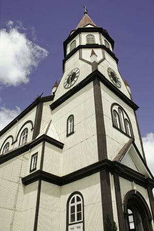 white wooden church in the city of Puerto Varas,south Chile photo