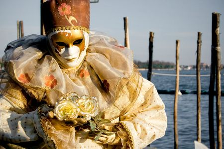 Venice mask shined by sun on a beautiful day. photo