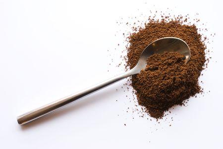 バック グラウンドでコーヒー スプーン