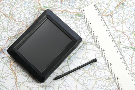 stylus pen: GPS global positioning device with stylus pen and ruler arranged with map Stock Photo