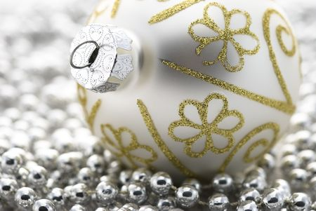 Christmas tree ball with silver beads Stock Photo