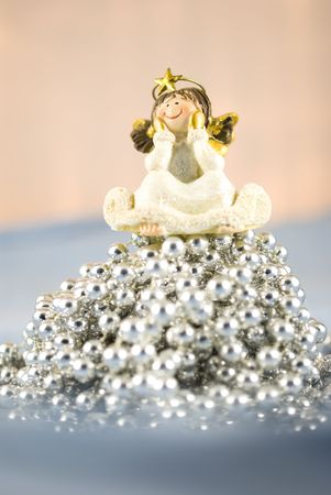 Christmas decoration angel sitting on silver beads  photo